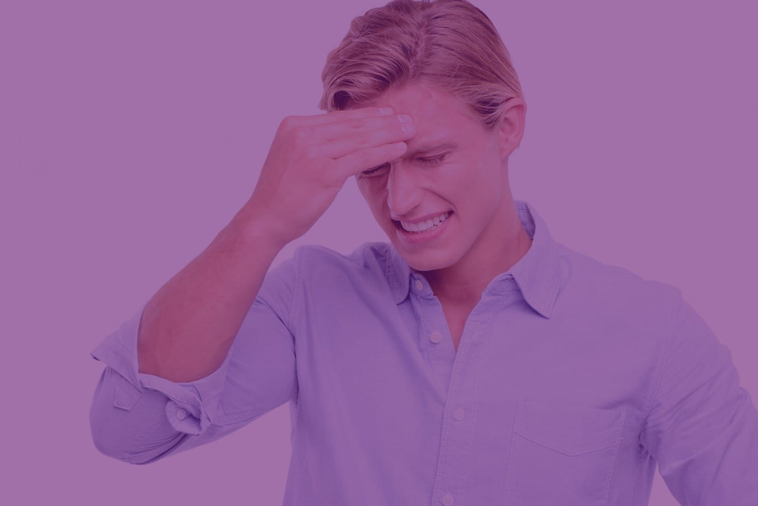 Man holding forehead in pain