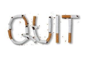 Quit smoking word written with broken cigarette concept for quitting smoking