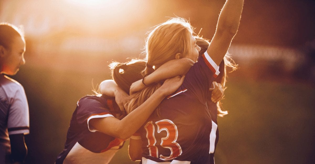 young women celebrating sports victory