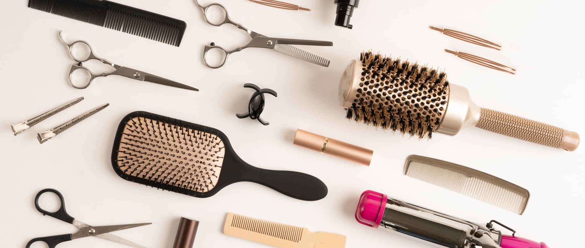 Haircare fulfillment products: brushes, combs, clips, and scissors.